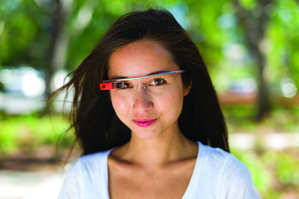 I - Google executive Amanda Rosenberg modeling the Google Glass face mounted wearable computer